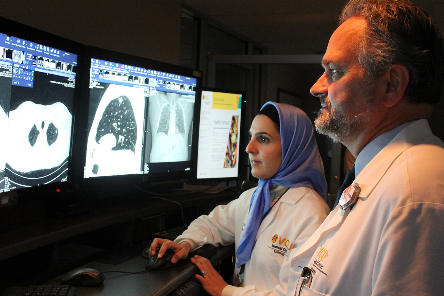 Doctors look at a lung scan.